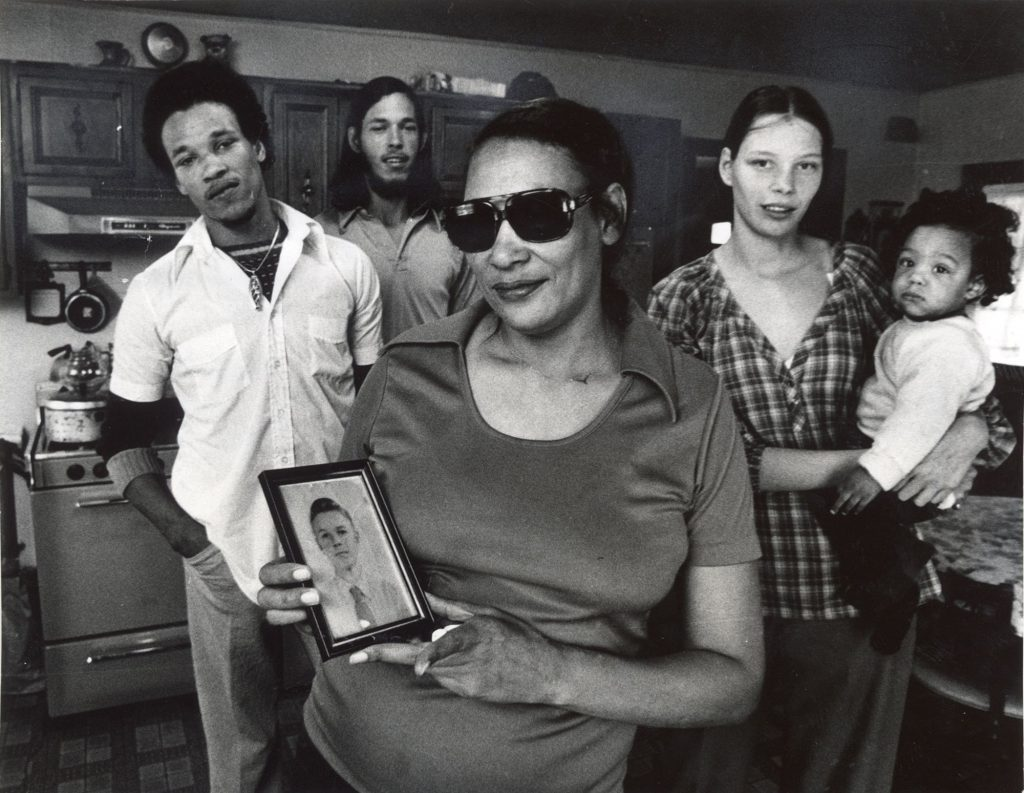 Mildred Loving Holding a Photo of Her Husband