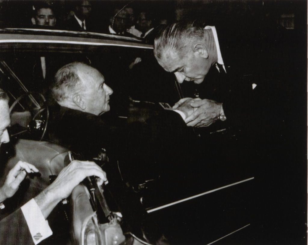 LBJ Kissing Harry F. Byrd's Hand