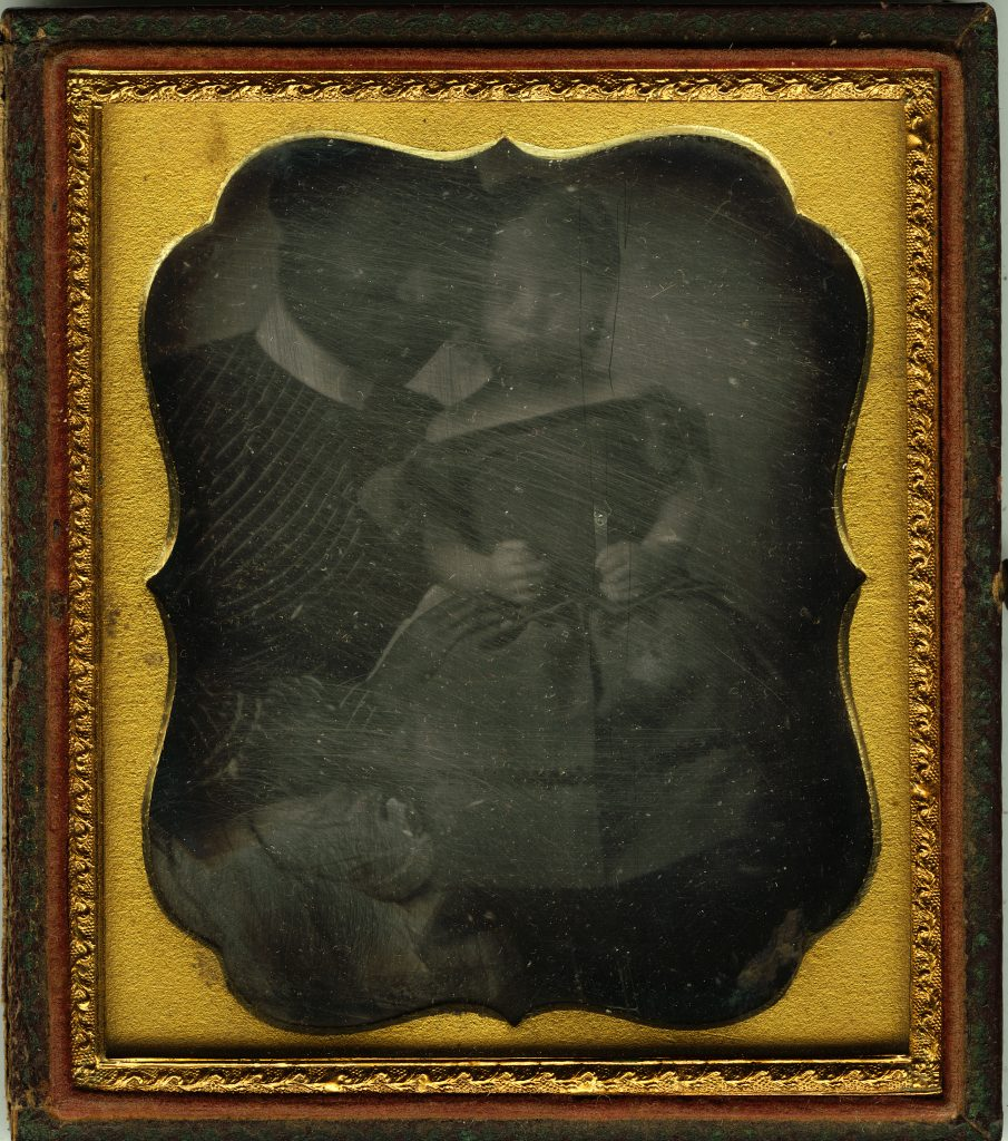 Daguerreotype of enslaved Black woman posing with a white child