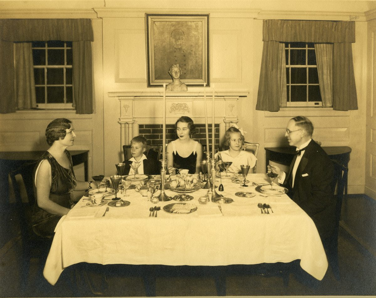 Douglas Southall Freeman and family seated at a formal dinner at home