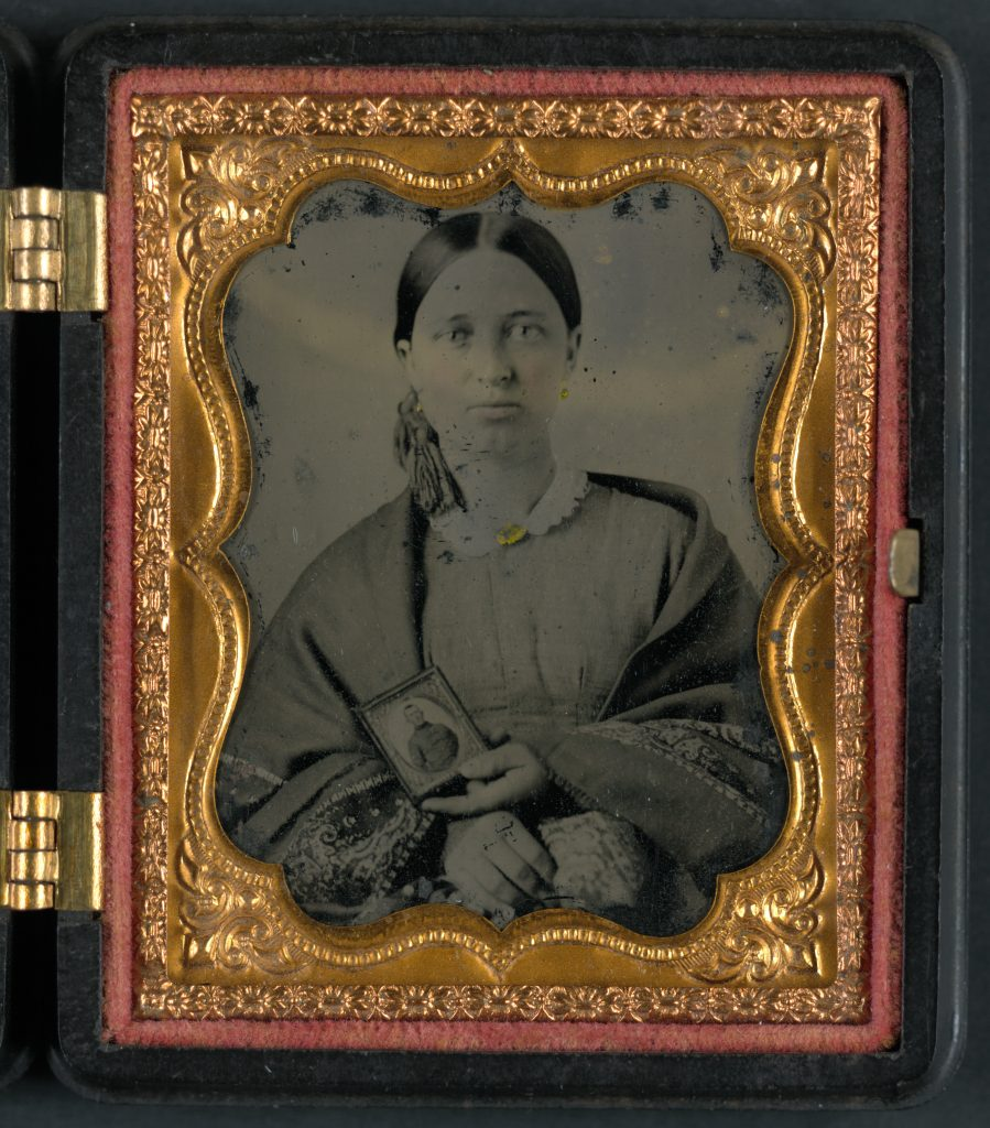 Woman Holding Portrait of Confederate Soldier