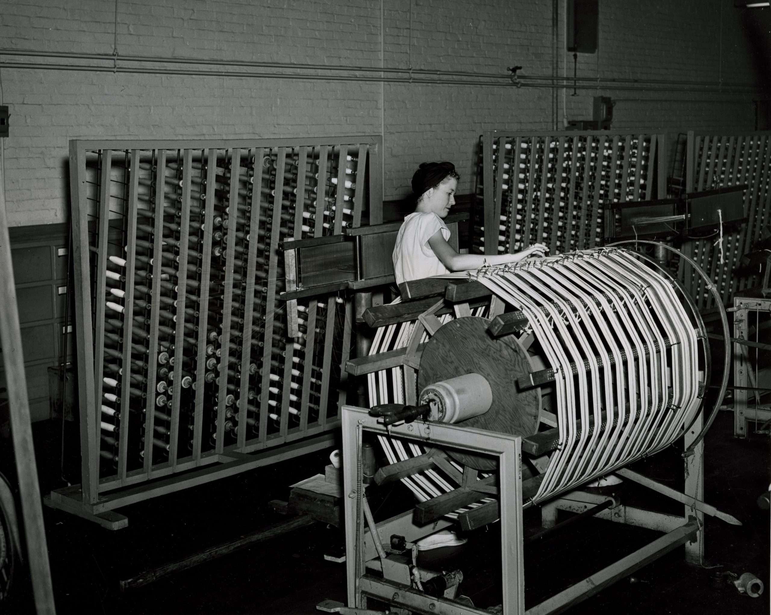 Woman Tending Machinery at Dan River Mills