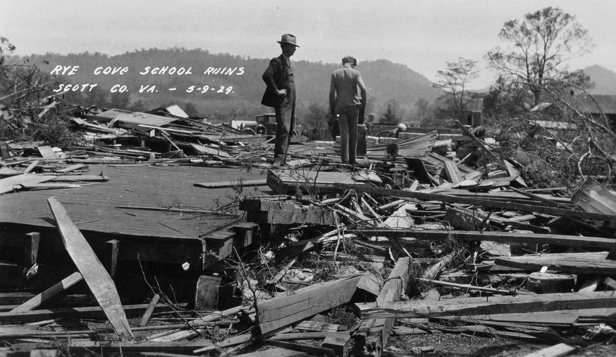 Men View the Ruins of Rye Cove School