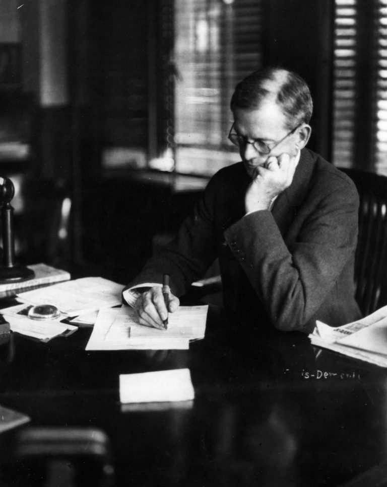 John Stewart Bryan at His Desk