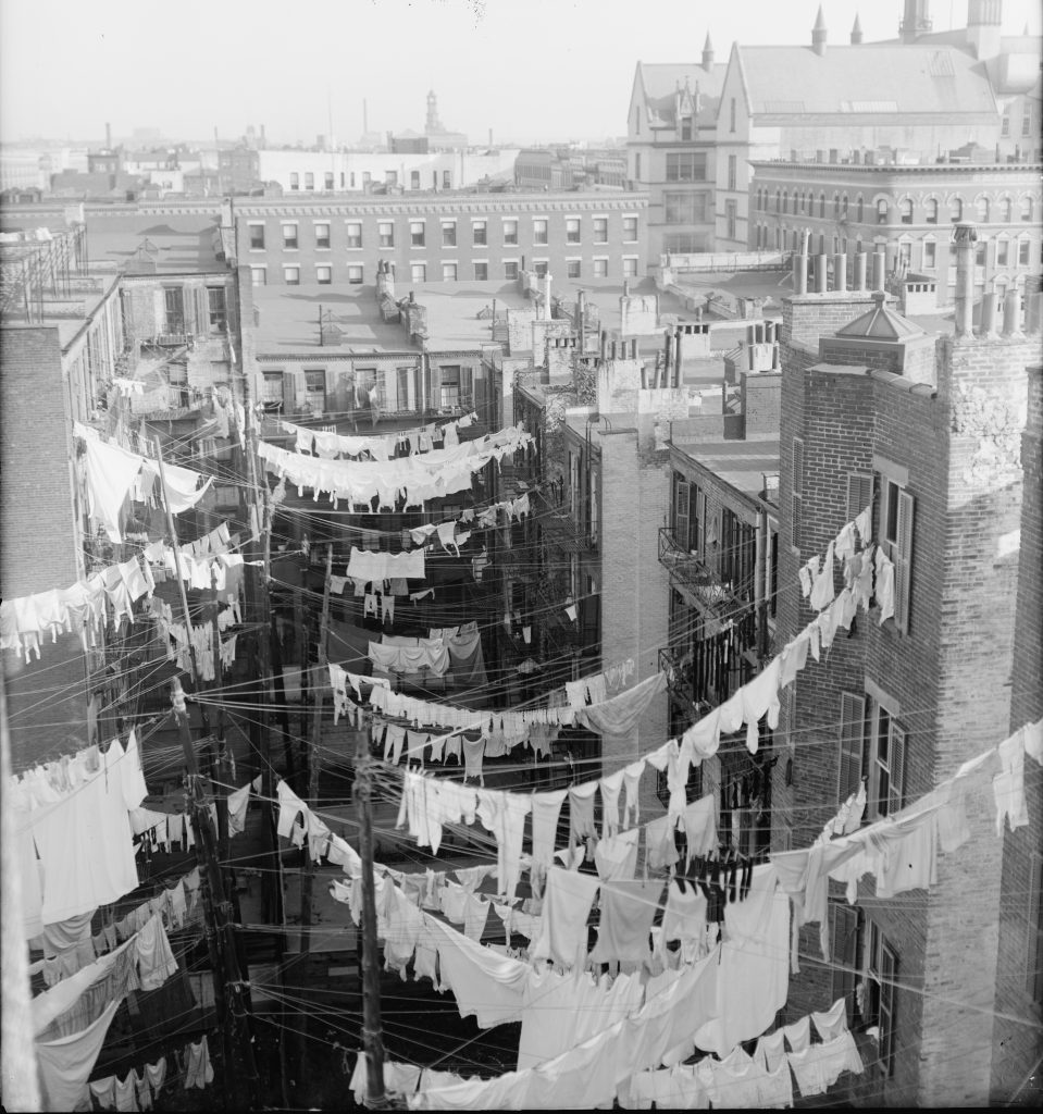 Laundry Hanging from Tenement Houses in New York