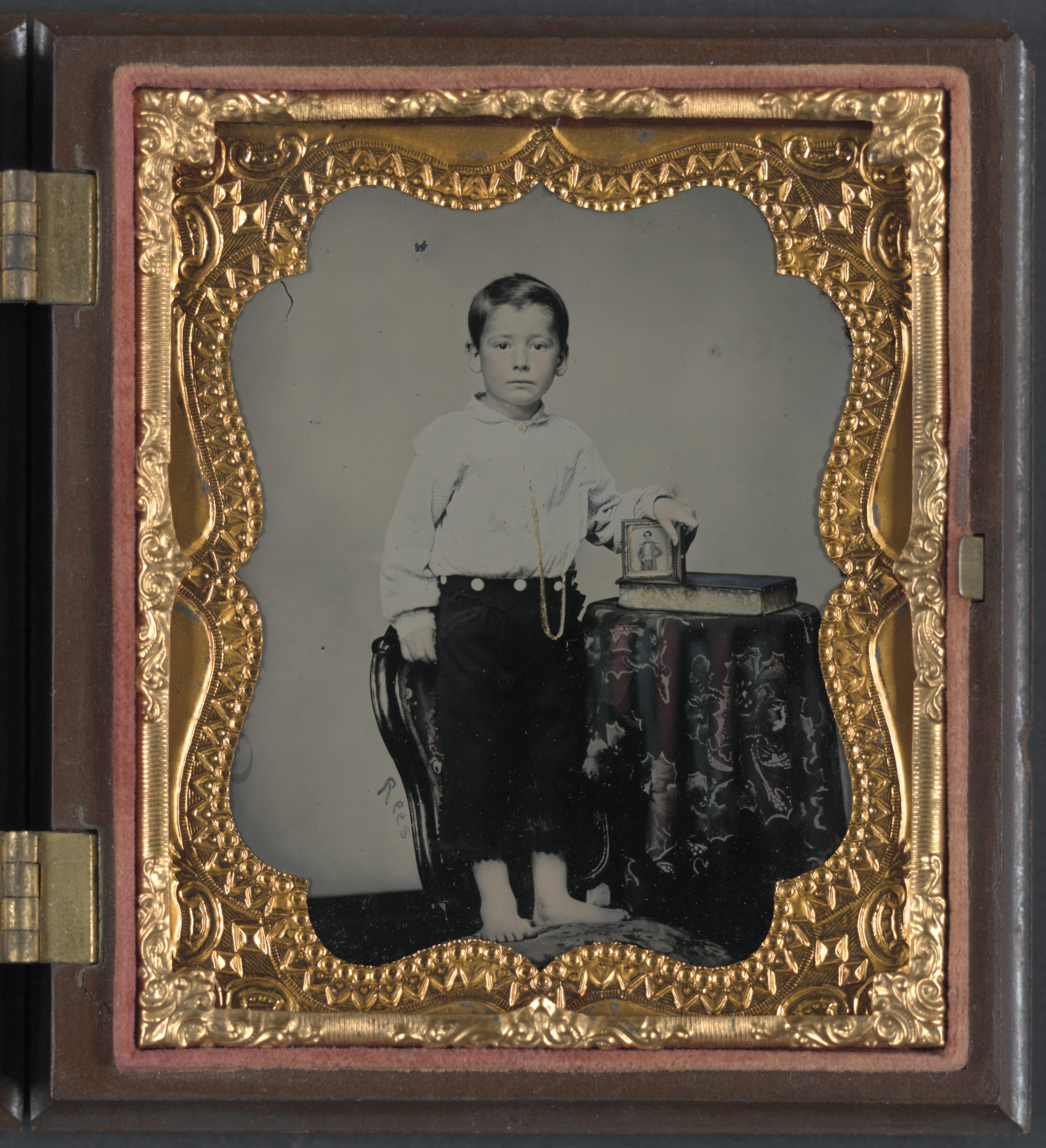 An Unidentified Boy Holds An Image of a Confederate Soldier