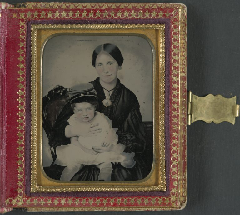 Woman in Mourning Dress Holding Child