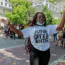 Dancing with outstetched arms to celebrate Juneteenth