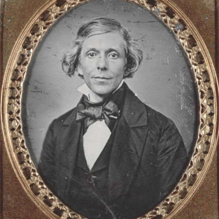 Daguerreotype portrait of William Greenleaf Eliot in a gold oval frame