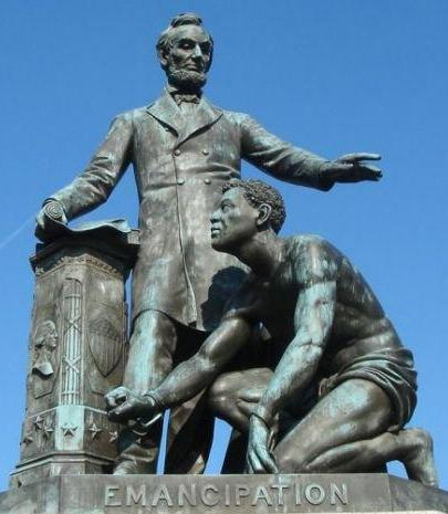 Emancipation Memorial depicting a formerly enslaved man with broken shackles on his wrist and Abraham Lincoln standing above him