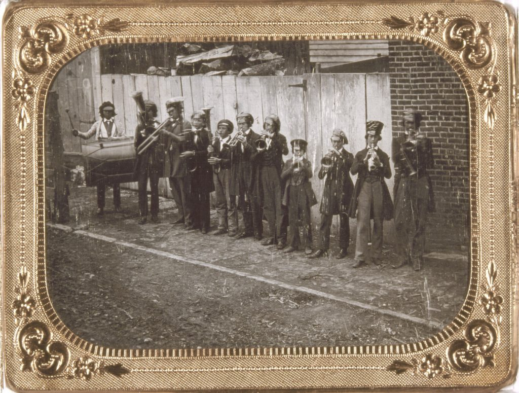 Eleven Germand boys play instruments on a street in St. Louis