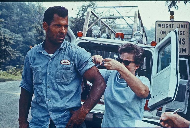 Utility worker being vaccinated for typoid after Hurricane Camille